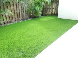 Synthetic grass installed in the side yard of a Tampa home