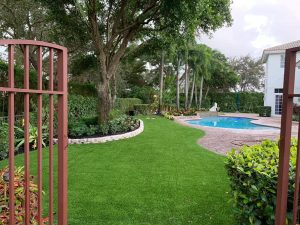 synthetic grass by the pool at a Boca Raton home