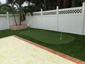 Artificial grass installed in a Miami backyard to be used as a putting green