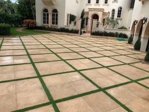 Artificial grass installed in the drive way of a Pompano Beach home